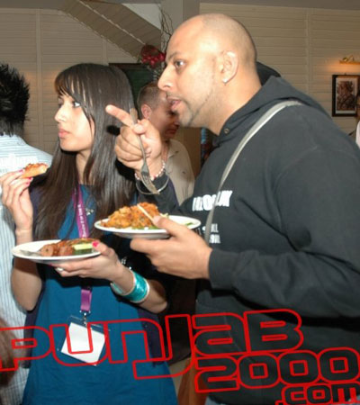Baja & Meena eating on the job (and on the sly as well lol).