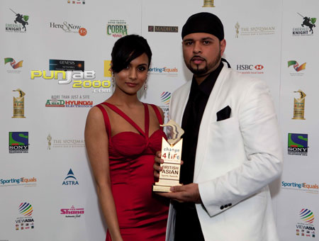 Raj Hundal wins Most Up and Coming Sports Personality of the Year at this year's Change4Life British Asian Sports Awards with singer Jaya
