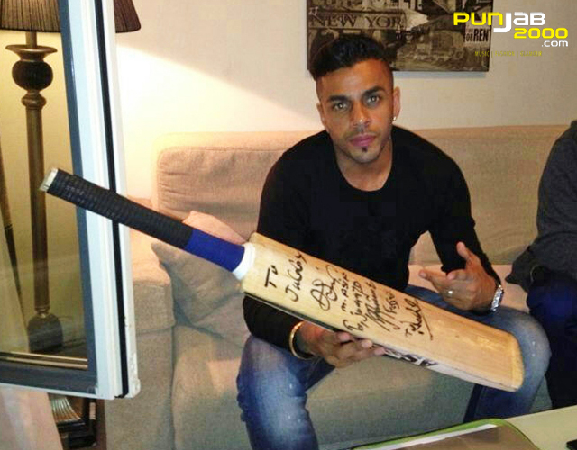 JuggyD with Cricket bat