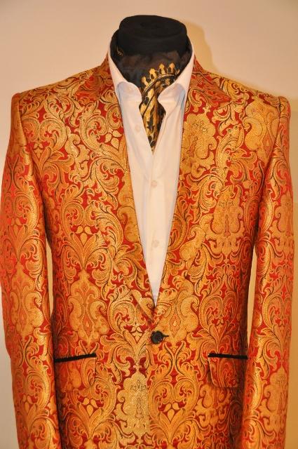 Bold print suit jacket dressed with patterned cravat style scarf designed by Julien Trivedi*