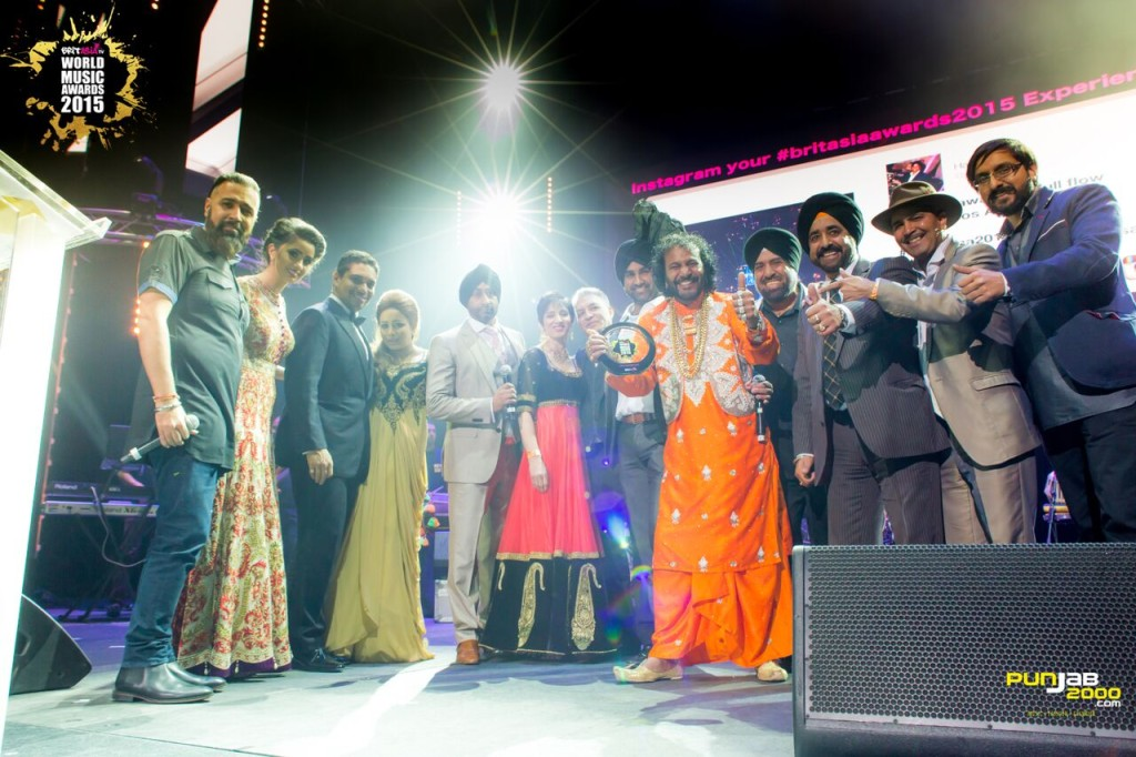 King G Mall receiving his lifetime achievement award at the BritAsia World Music Awards 2015 at Barclaycard Arena
