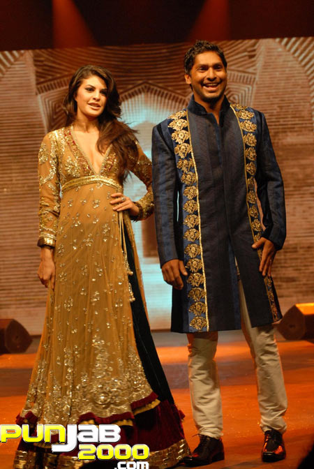 Jacqueline Fernandez and Sangakkara - showstoppers for Manish Malhotra at the IIFA Fashion Extravaganza