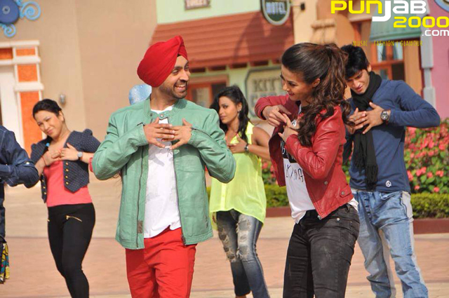 Diljit Dosanj & Surveen Chawla in the song Beautiful Billo
