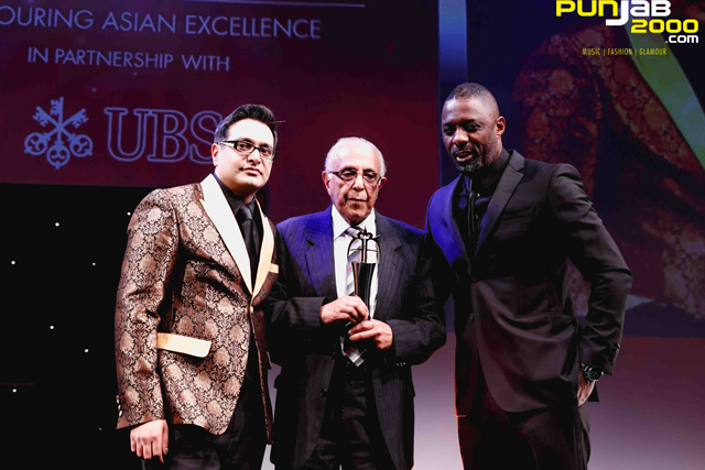 Actor Idris Elba presenting the Founders Award to Ahmed Kathrada (one of Nelson Mandela's closest friends, former cellmate at Robben Island, anti-Apartheid activist and politician) at Friday's Asian Awards. A truly emotional moment that obviously garnered standing ovation.