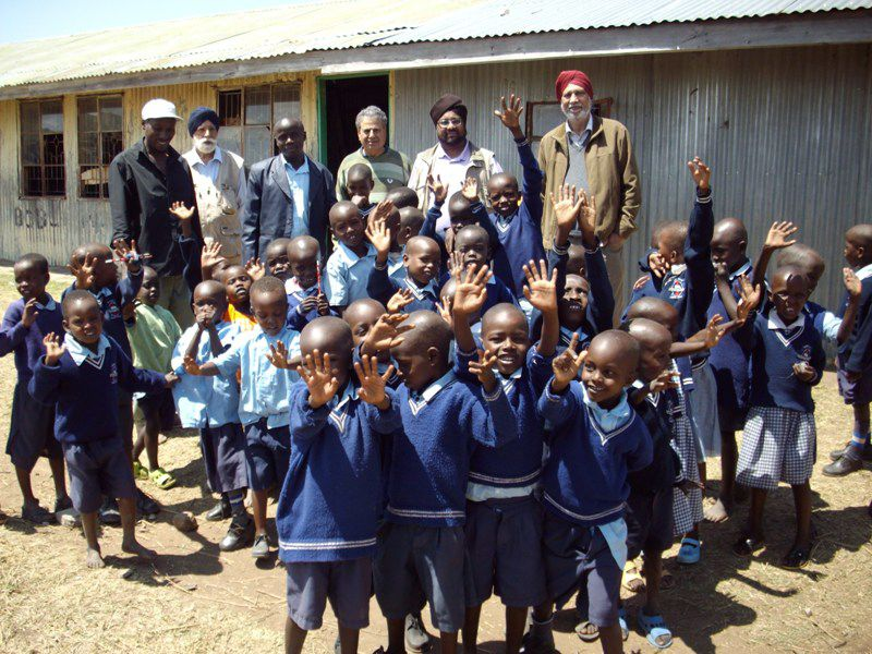 Sikh Union with overjoyed school children at Water Project 2013 in Africa