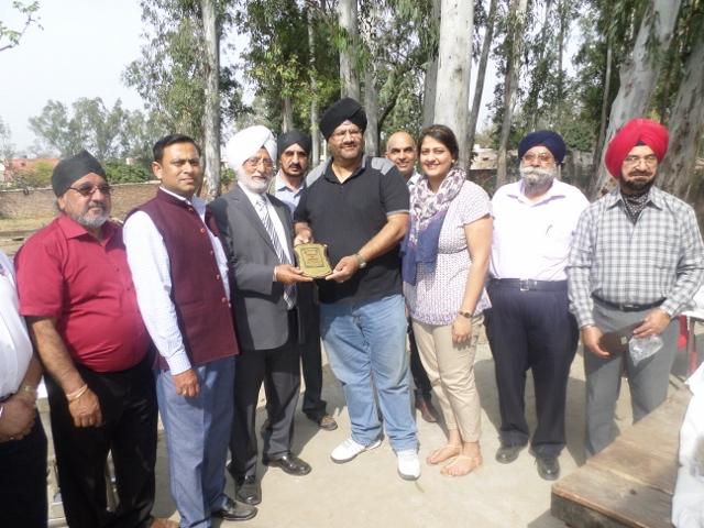 Northampton Punjabi Associaton receiving charitable award for participation in the Jalandhar Sikh Union Eye Camp 2014